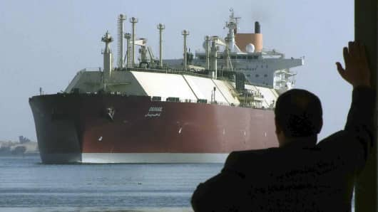 A man looks as the world's biggest Liquefied Natural Gas (LNG) tanker DUHAIL as she crosses through the Suez Canal. The Qatari tanker, which was built to transfer LNG from Qatar to Europe and the U.S., is on her first trip ever from Qatar to Spain.