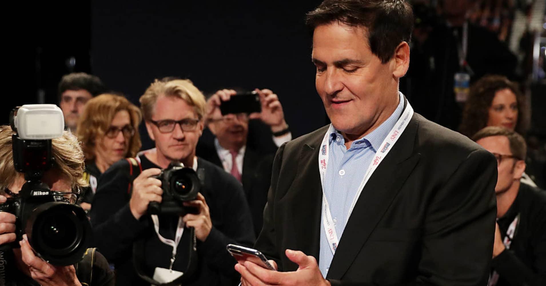 Mark Cuban checking his phone