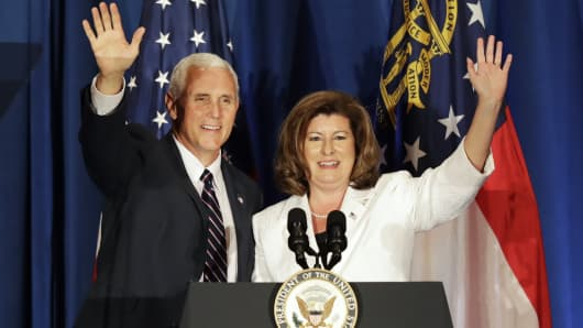 Vice President Mike Pence, left, steps onstage at a campaign fundraiser for Republican candidate for 6th congressional district Karen Handel, right, at the Cobb Energy Performing Arts Centre in Atlanta, Ga., Friday, June 9, 2017.