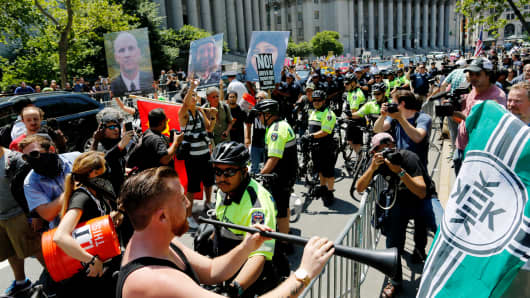 NYPD officers try to separate counter-protesters and activists rallying for the 'March Against Sharia' on June 10, 2017 in New York City.