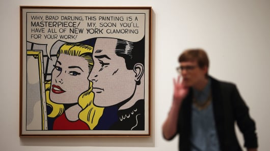A visitor stands in front of a painting entitled 'Masterpiece,' during a press preview of 'Lichtenstein, a Retrospective' at the Tate Modern on February 18, 2013 in London.