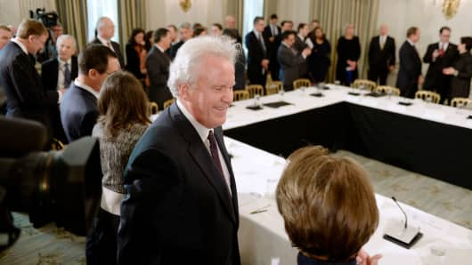 Jeff Immelt, then-chairman and chief executive officer of General Electric Co, speaks with an attendee during a meeting with President Donald Trump, not pictured, and manufacturing executives in the State Dining Room of the White House in Washington, D.C.