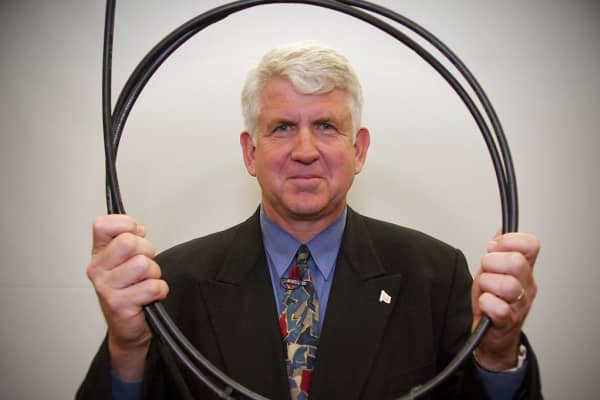 Bob Metcalfe, the co-inventor of the Ethernet, holding an original piece of Ethernet cable.