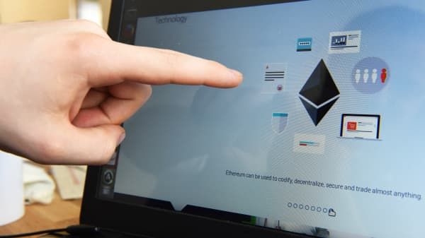 The technology of the Ethereum platform is represented on a computer screen at the Ethereum DEV offices in Berlin, Germany, 14 April 2015. Ethereum is an open source platform that hosts applications and data on a decentralized network.