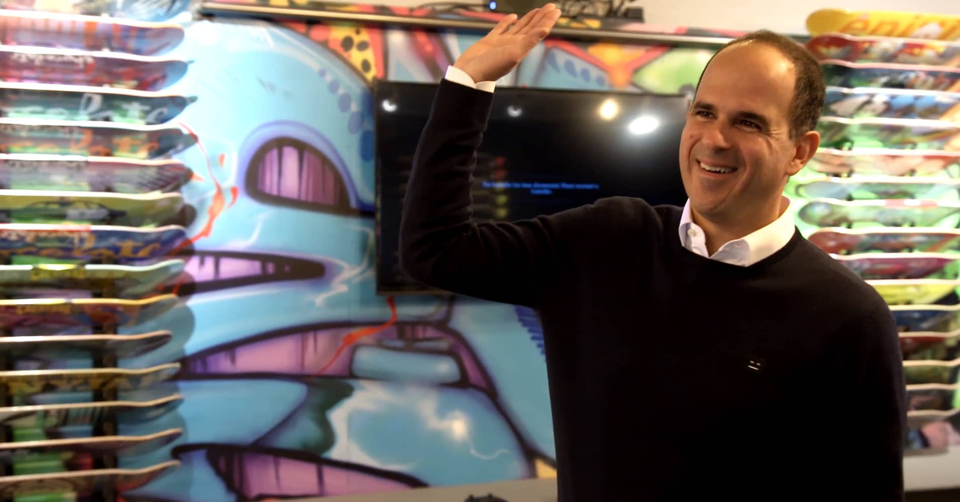 Marcus Lemonis high fives an employee after a successful renovation.