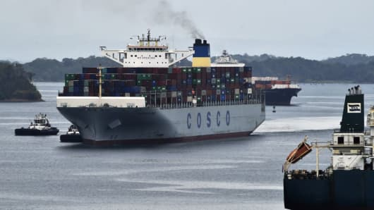 Container ship Cosco Development, registered and sailing under the flag of Hong Kong, with capacity for more than 13,000 containers, is seen at the Agua Clara locks in Colon, 90 km from Panama City on May 2, 2017. The Cosco Development became Thursday the largest ship to cross the Panama Canal.