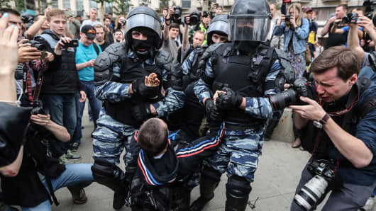 Police detain a participant in an unauthorised rally on Tverskaya Street.
