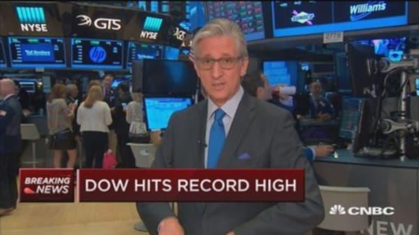 Market opens higher amid 'Fed drift'