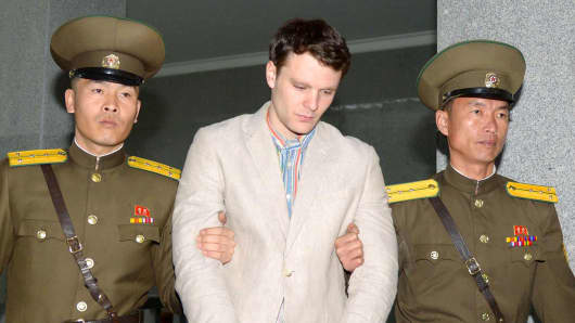 Otto Warmbier (C), a University of Virginia student who was detained in North Korea from January 2016, is taken to North Korea's top court in the capital Pyongyang in this photo released March 16, 2016.