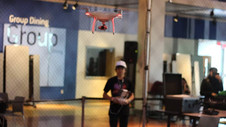 Tayler Mongiovi flies a DJI drone at the Day of Drones in Liberty Science Center, NJ.