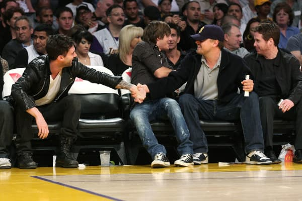 Adam Levine and Leonardo DiCaprio shake hands at a Laker's game in 2008.