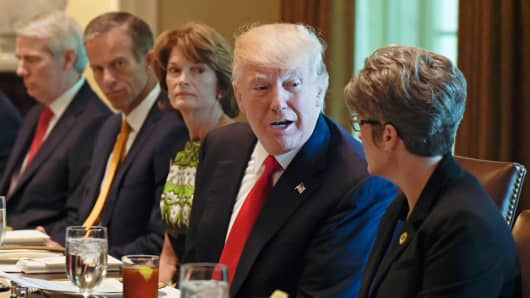 President Donald Trump talks with Sen. Joni Ernst, R-Iowa in the Cabinet Room of the White House in Washington, Tuesday, June 13, 2017, before having lunch with Republican Senators. From left are, Sen. Rob Portman, R-Ohio, Sen. John Thune, R-S.D., and Sen. Lisa Murkowski, R-Alaska the president and Ernst.