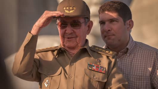 Cuban President Raul Castro, next to his grandson and bodyguard, Raul Rodriguez Castro, attends the May Day parade at Revolution Square of Havana, on May 1, 2017.