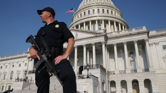 A U.S. Capitol Police officer stands guard in front of the U.S. Capitol Building, on June 14, 2017 in Washington, DC.