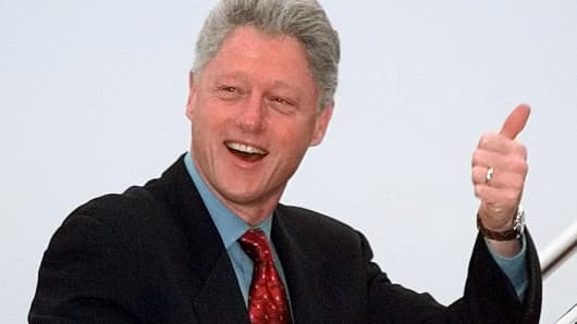 President Bill Clinton smiles and gives the 'Thumbs Up' sign while boarding Air Force One at Andrews Air Force Base near the nation's capital en route to Los Alamos, New Mexico in 1998.