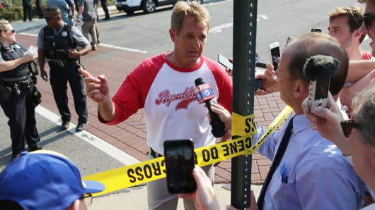 U.S. Sen. Jeff Flake (R-AZ) briefs members of the media near Eugene Simpson Stadium Park where a shooting took place on June 14, 2017 in Alexandria, Virginia.