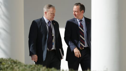 White House Press Secretary Sean Spicer (L) and White House Chief of Staff Reince Priebus walk down the West Wing Colonnade following a bilateral meeting between U.S. President Donald Trump and Japanese Prime Minister Shinzo Abe February 10, 2017 in Washington, DC.