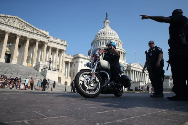 U.S. Capitol Police stand guard in front of the U.S. Capitol Building, on June 14, 2017 in Washington, DC.