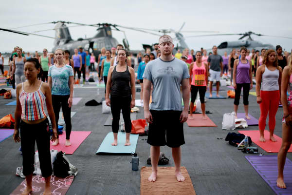 Large yoga session aboard the USS Midway in San Diego.