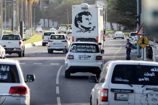 June 11, 2017: Cars in Doha with portraits of Qatar's Emir Sheikh Tamim bin Hamad Al-Thani and text reading in Arabic: 'Tamim the glorious.' The diplomatic crisis surrounding Qatar and other Gulf countries has remained a peaceful one for now, but open warfare has been declared in the media - both traditional and social.