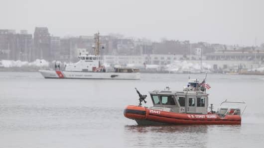U.S. Coast Guard boats patrol Boston Harbor on January 6, 2015 in Boston, Massachusetts.