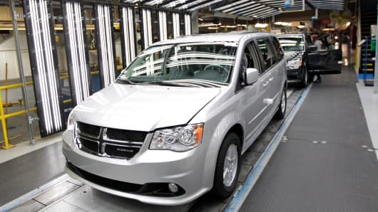 Dodge Grand Caravan vehicles move down the production line at Chrysler's assembly plant in Windsor, Ontario, Canada, Jan. 18, 2011.