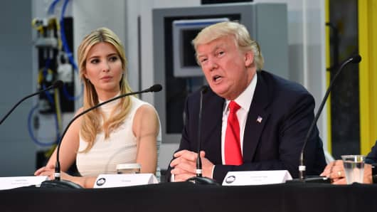 President Donal Trump (R) and his daughter Ivanka (L) chairs a a workforce development roundtable discussion at Waukesha County Technical College during his visit in Milwaukee, Wisconsin on June 13, 2017.