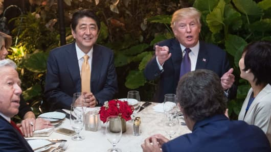 President Donald Trump and Japanese Prime Minister Shinzo Abe sit down for dinner at Trump's Mar-a-Lago resort on February 10, 2017.