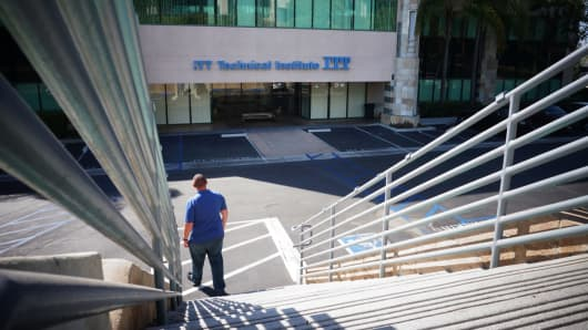 A student outside ITT Technical Institute after it abruptly closed, in Vista, California, Sept. 6, 2016. It seems only right that victims of predatory for-profit education companies should have their student loans forgiven.