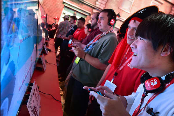 Fans play 'Super Mario Odyssey' with Nintendo Switch gaming console at the Los Angeles Convention Center during E3 2017, on June 13, 2017.