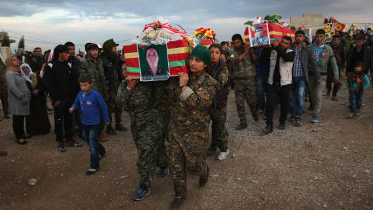 Members of the female division of the People's Protection Units (YPG), carry the body of comrade Roj Adiyaman, one of eight soldiers that were buried in the martyrs' cemetery on November 8, 2015 in Derek, Rojava, Syria. The U.S., Russia and Iran are all involved in the Syrian Civil War. They are all working to defeat ISIS, but for different reasons.