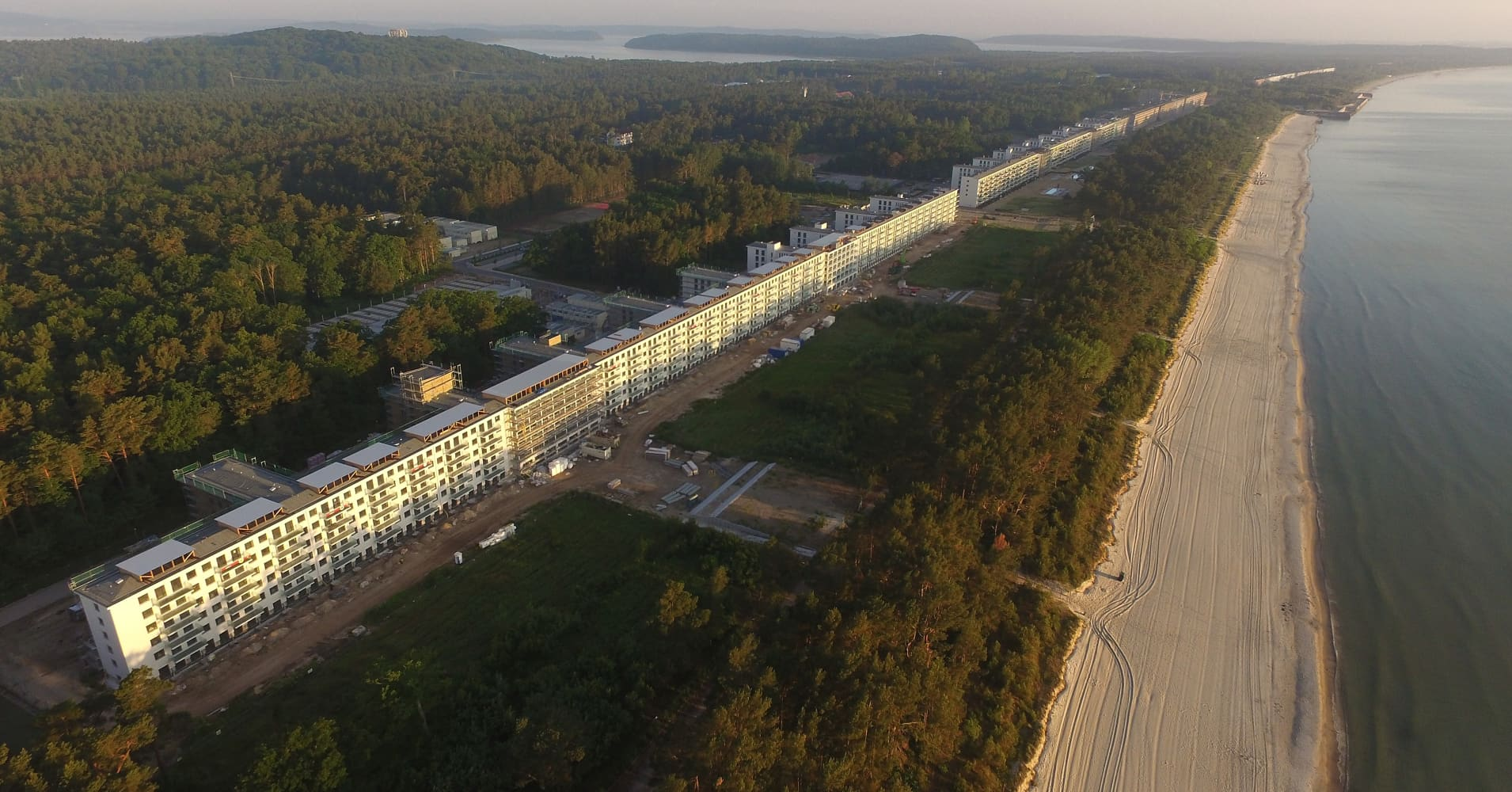 In this aerial view blocks of the Prora building complex stretch along the beach on Ruegen Island on June 15, 2017 in Binz, Germany.