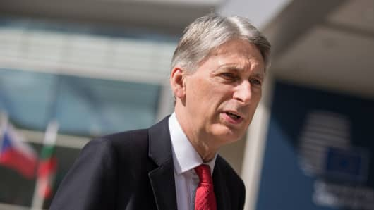 Philip Hammond, U.K. chancellor of the exchequer, speaks to journalists as he arrives for an Ecofin meeting of European Union (EU) finance ministers in Luxembourg on Friday, June 16, 2017.