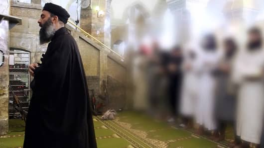 Abu Bakr al-Baghdadi preaching during Friday prayer at a mosque in Mosul.