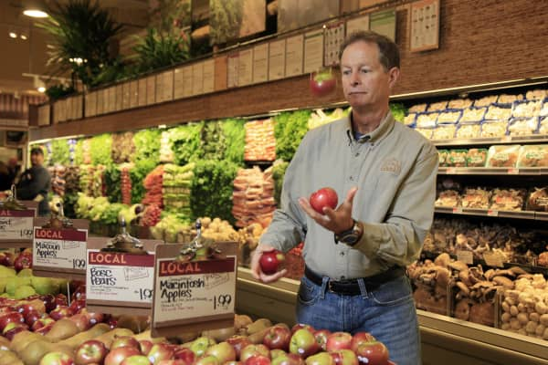 Whole Foods CEO John Mackey juggles apples as as he's photographed in one of his stores on New York's Upper West Side.