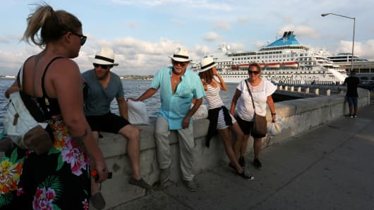Tourists sit near a cruise ship in Havana, Cuba May 15, 2017.