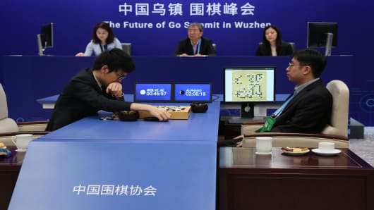 Ke Jie, left, takes on the AlphaGo AI Go player represented by Aja Huang during the second of three games at the Future of Go Summit in China in May 2017.