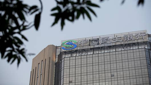The logo for the China Minsheng Banking is displayed atop their building in Guangzhou, Guangdong Province, China.