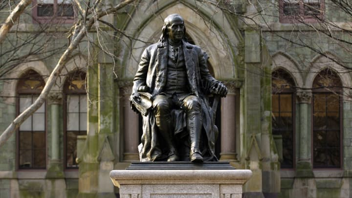 A statue of Benjamin Franklin, founder of the University of Pennsylvania, on the school's campus in Philadelphia, Pennsylvania.