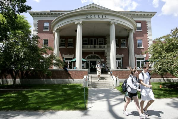 Students walk outside the Collis building on the campus of Dartmouth College, the smallest school in the Ivy League, in Hanover, New Hampshire.