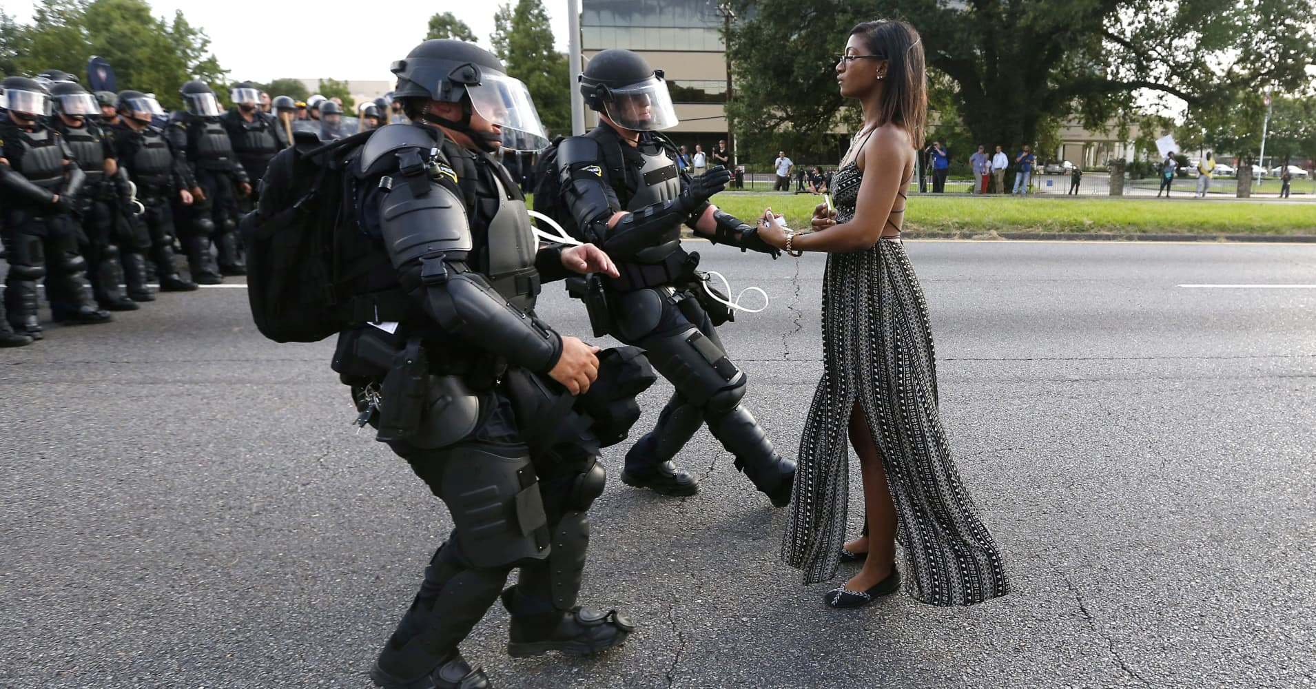Ieshia Evans is detained by law enforcement as she protests the shooting death of Alton Sterling near the headquarters of the Baton Rouge Police Department in Louisiana, U.S. July 9, 2016.