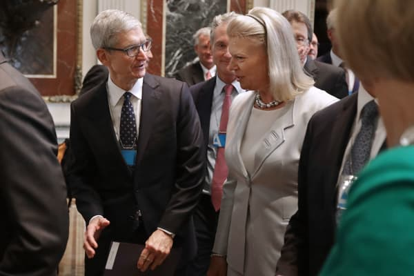 Apple CEO Tim Cook (L) and IBM CEO Ginni Rometty attend the inaugural meeting of the American Technology Council in the Indian Treaty Room at the Eisenhower Executive Office Building next door to the White House June 19, 2017 in Washington, DC.