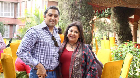 Fashion Designer Ritu Kumar with her son Amrish Kumar during a party in New Delhi, India on February 18, 2017.