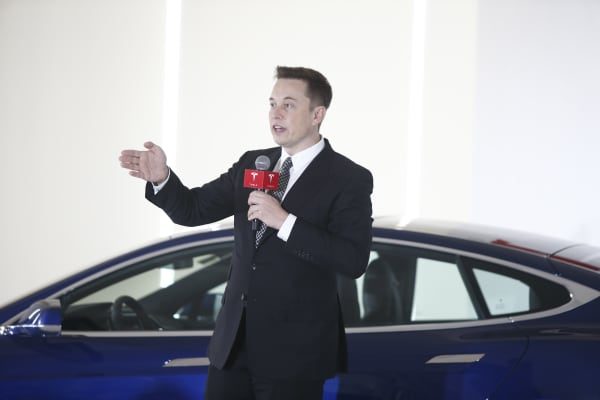 Elon Musk, Chairman, CEO and Product Architect of Tesla Motors, addresses a press conference to declare that the Tesla Motors releases v7.0 System in China on a limited basis for its Model S, which will enable self-driving features such as Autosteer for a select group of beta testers on October 23, 2015 in Beijing, China.
