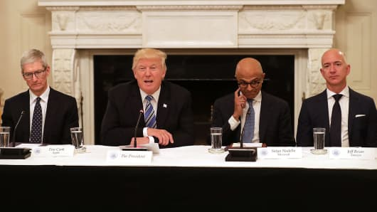 President Donald Trump (2nd L) welcomes members of his American Technology Council, including (L-R) Apple CEO Tim Cook, Microsoft CEO Satya Nadella and Amazon CEO Jeff Bezos in the State Dining Room of the White House June 19, 2017 in Washington, DC.