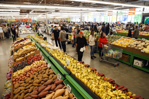 Customers browse produce for sale while shopping on the opening day of the 365 by Whole Foods Market store in the Silver Lake neighborhood of Los Angeles, California, U.S., on Wednesday, May 25, 2016.