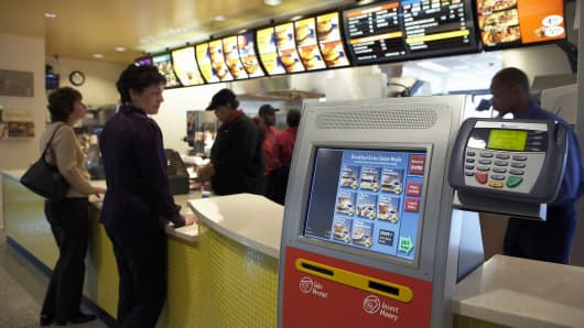 McDonald's is testing new ordering kiosks at a working restaurant at the company's Oak Brook, Illinois headquarters.