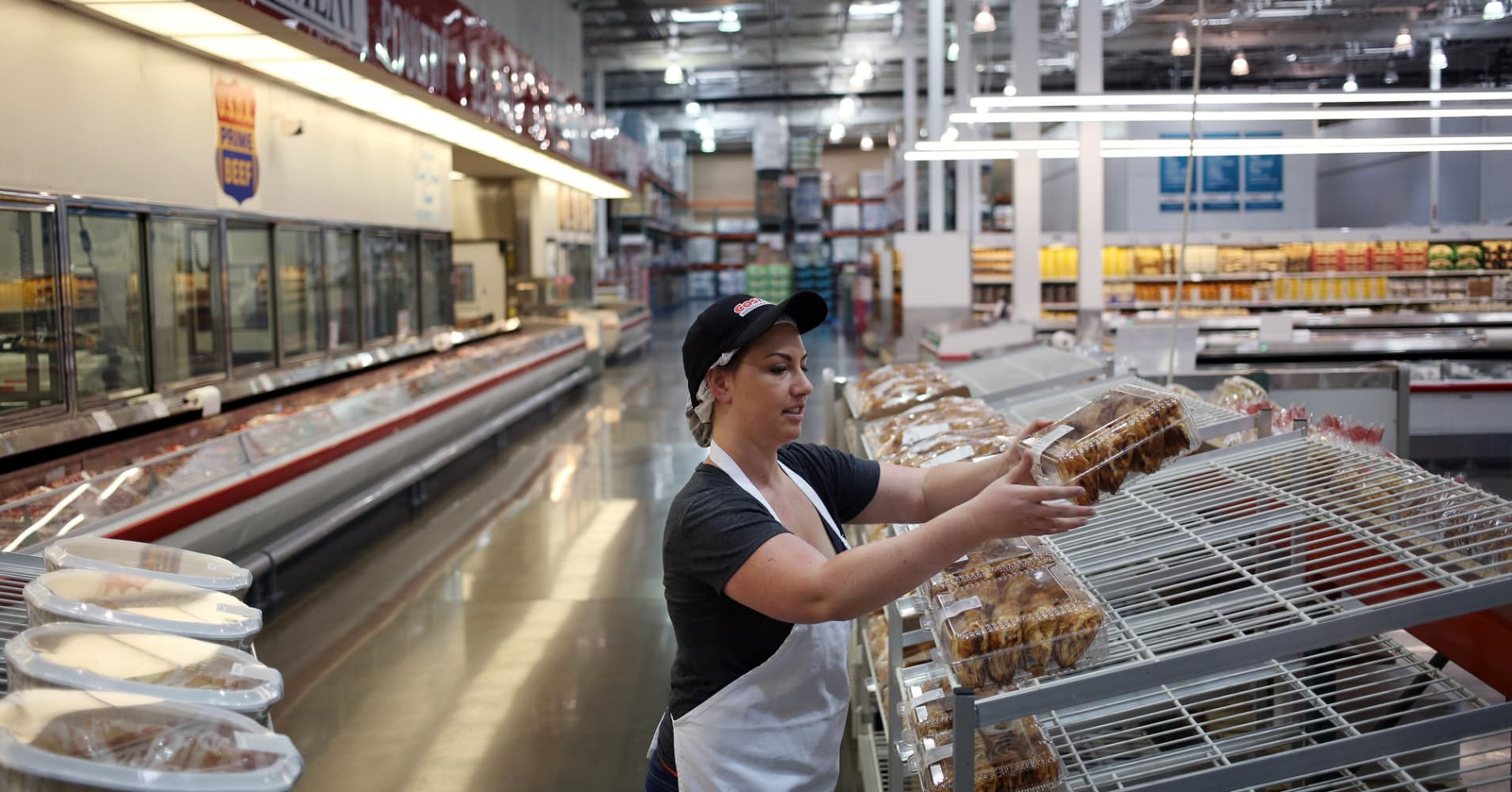 A bakery employee distributes baked goods onto a display rack inside a Costco Wholesale Corp. store in Nashville, Tennessee, U.S.
