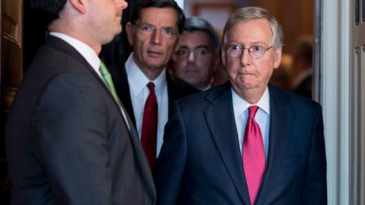 Senate Majority Leader Mitch McConnell, R-Ky., followed by Sen. John Barrasso, R-Wyo., and Sen. Cory Gardner, R-Colo.