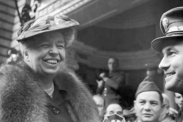 Eleanor Roosevelt joins American soldiers at the Washington Club in London, England.